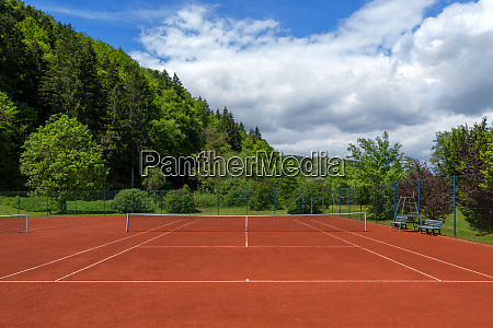 clean pulled tennis court with red