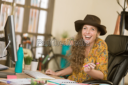 stylish woman laughing in a creative