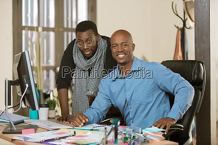 smiling business men at work