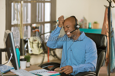 stressed african american business man on