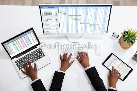 businessperson doing multitasking work
