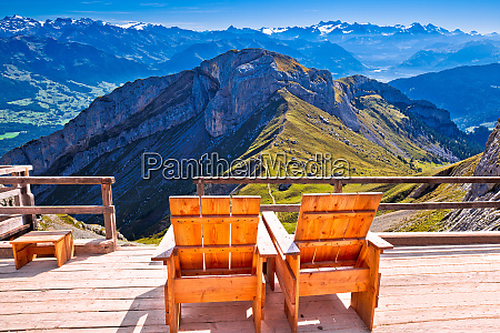 relax deck chair swiss alps panorama