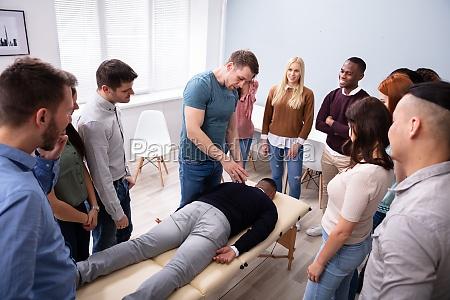 man giving teaching massage to group