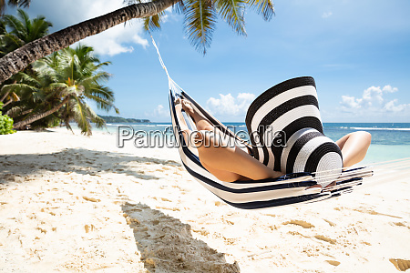 woman relaxing on hammock over the