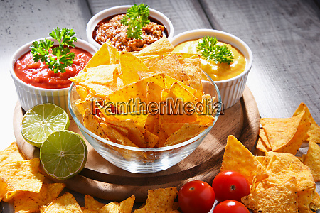 composition with bowl of potato chips