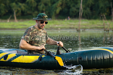 rowing in inflatable boat