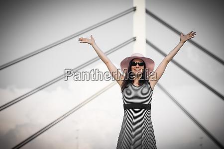 happy woman hands up