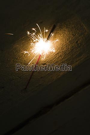 a firework sparkler on the ground