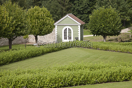 guard house at a landscaped lawn