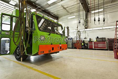 green garbage truck maintenance