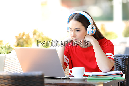 studious student e learning watching tutorials