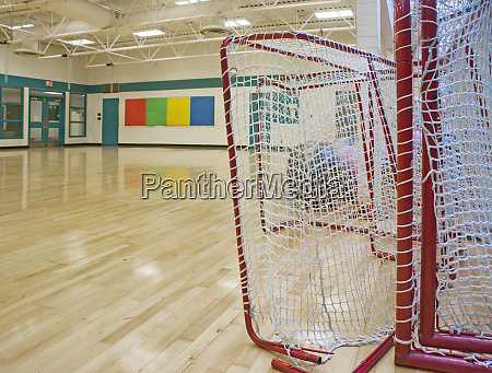 lacrosse goals in a gymnasium