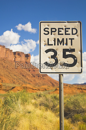 bullet holes in speed limit sign