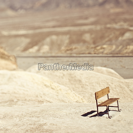 an empty bench in the desert