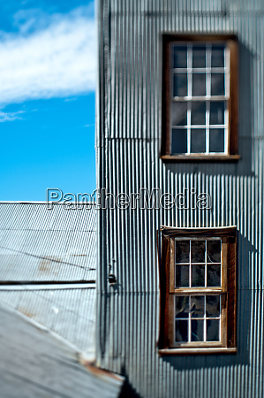 windows in a wall with metal