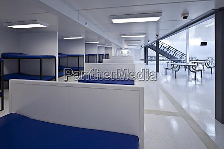 beds in minimum security jail corridor