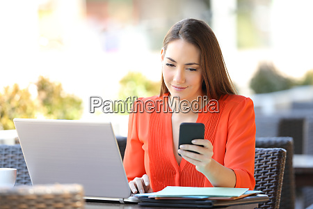 entrepreneur checking phone working in a