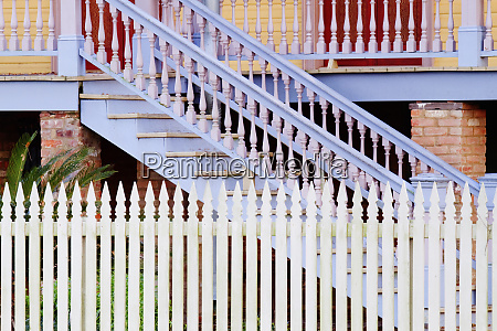 stairs and white picket fence