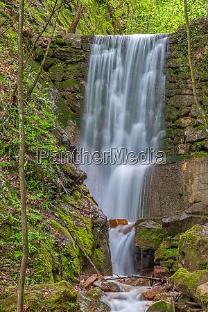 waterfall in rastenbach gorge at lake
