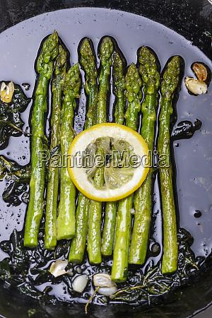 green asparagus in an iron pan