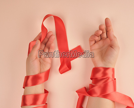 two female hands wrapped in a