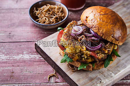 crispy fried mealworm insect burger on