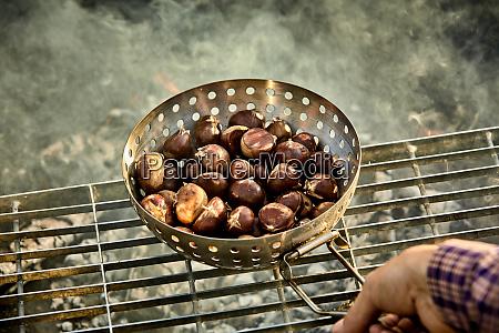 man roasting a batch of fresh