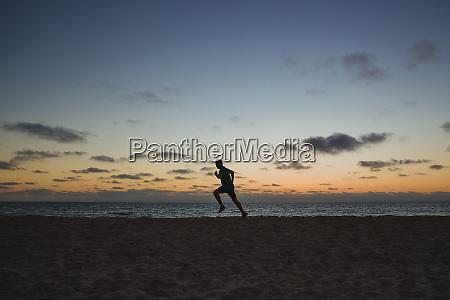 jogging across the beach