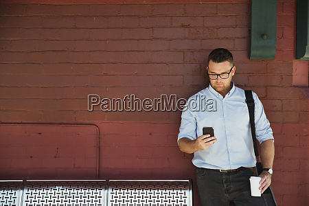 businessman waiting at the train station