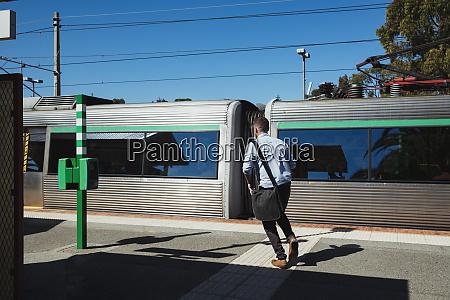 businessman chasing the train
