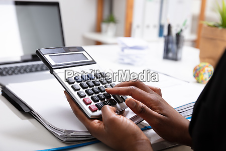 businesswoman calculating bill
