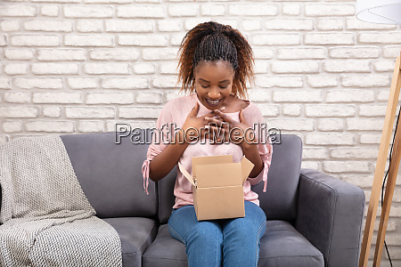 woman opening the parcel box