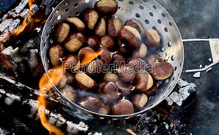 roaster full of fresh sweet chestnuts