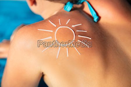sun drawn on womans back with
