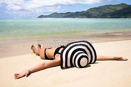 young woman in bikini lying on