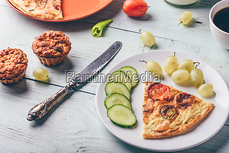 slice of frittata with cup of