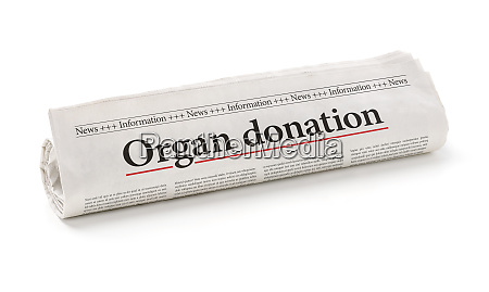 rolled newspaper with the headline organ
