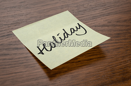sticky note with the text holiday