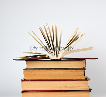 stack of books and an open