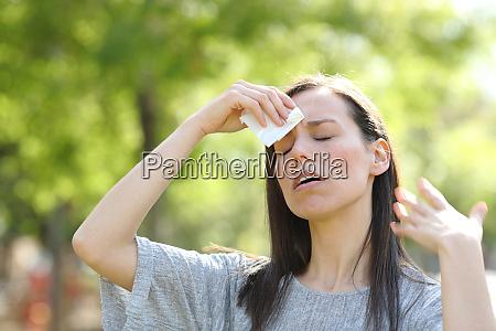 woman drying sweat using a wipe