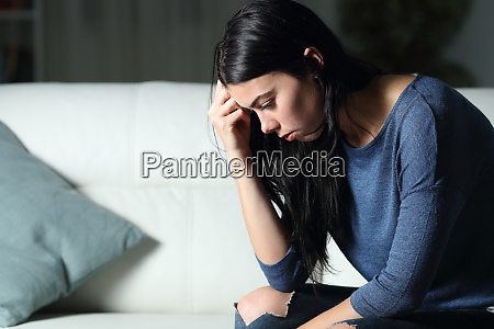worried woman thinking alone in the