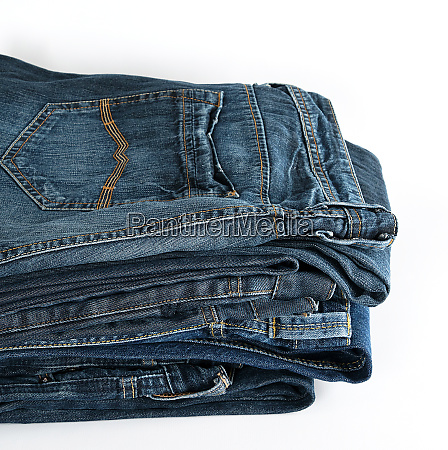 stack of folded blue jeans on
