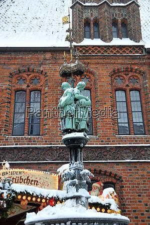 fountain figure between the christmas market