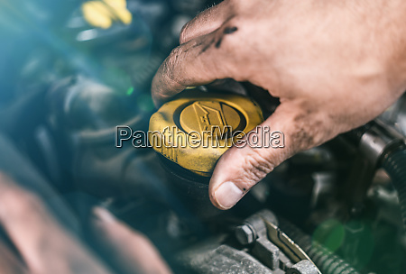 auto mechanic working in garage repair