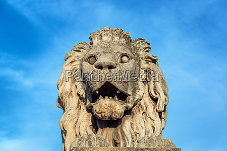 lion on budapest chain bridge