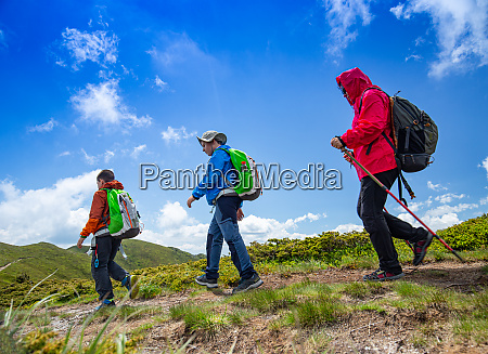 mother and two boys hike