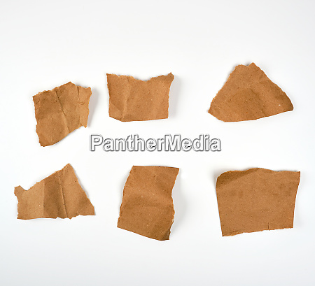 torn brown pieces of parchment paper