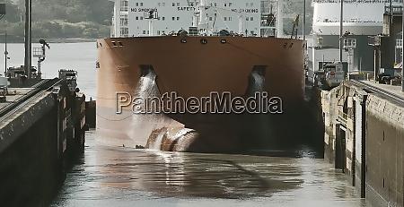 cargo ship entering miraflores locks at