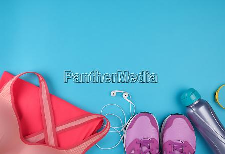 pink womens sneakers bottle of water