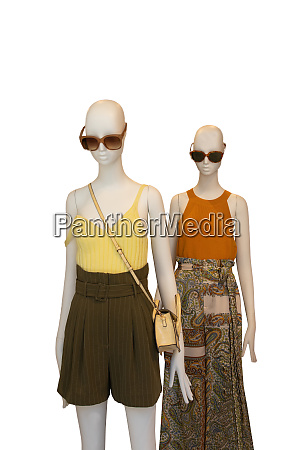 two mannequin dressed with female yellow